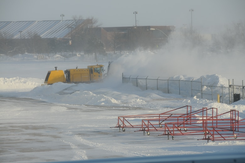 Master Sgt. Kevin Daehling blows snow from a ramp access road at the Nebraska Air National Guard Base on January 7, 2010. Lincoln, Neb. had a record of over 24 inches of snowfall in December 2009.(Nebraska Air National Guard photo by Senior Master Sgt. Lee Straube)