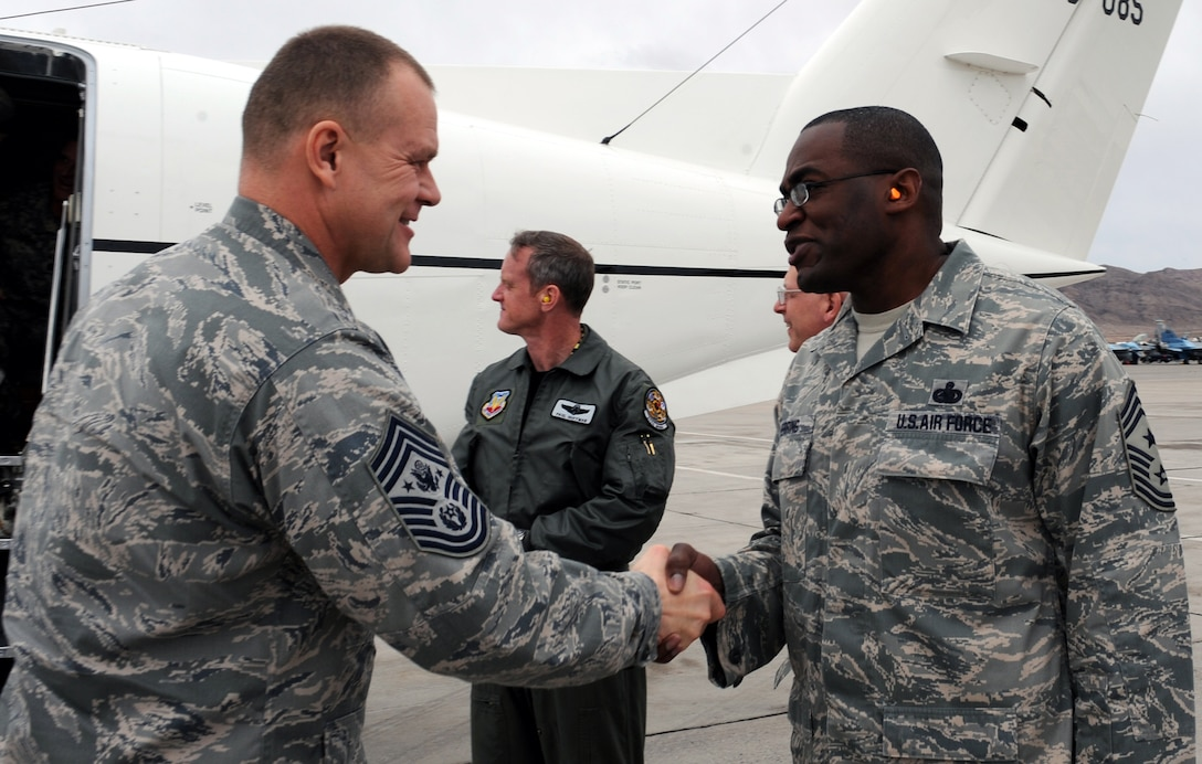 Chief Master Sgt. of the Air Force James A. Roy is greeted by Chief Master Sgt. Alfred Herring at base operations Jan. 22, 2010 at Nellis Air Force Base, Nev. Chief Herring is the  the 99th Air Base Wing command chief. (U.S. Air Force photo/Airman 1st Class Brett Clashman)