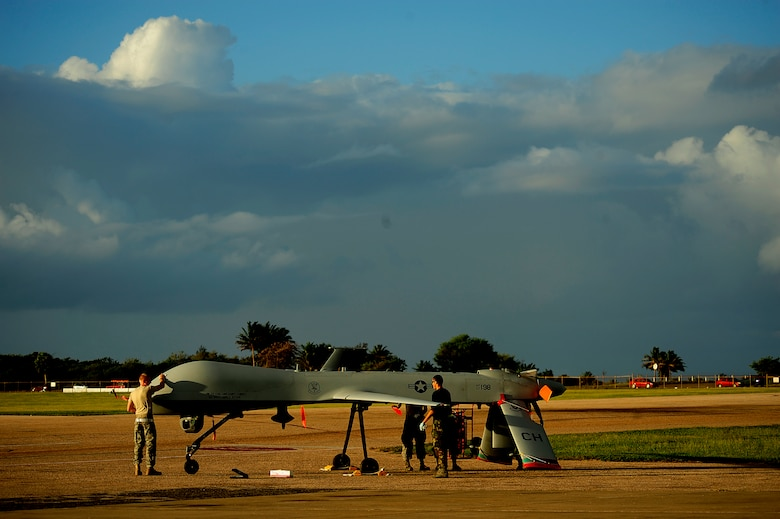 U.S. Air Force maintenance personnel from the 432nd Aircraft Maintenance Sq., Creech Air Force Base, Nevada conduct pre-flight maintenance on an RQ-1 Predator at Aeropuerto Rafael Hernandez outside Aguadilla, Puerto Rico on 28 Jan., 2010.  The RQ-1 remotely piloted systems are operating out of Puerto Rico in support of Operation Unified Response in Haiti.  Airmen from Creech Air Force Base, Las Vegas, Nev. are providing 24 hour a day full-motion video in real time to international relief workers on the ground in order to speed humanitarian aid to remote and cut-off areas of the country following the earthquake on 12 Jan., 2010. (U.S. Air Force photo by Tech. Sgt. James L. Harper Jr.)