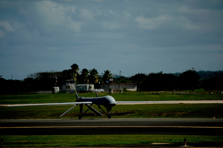 A U.S. Air Force RQ-1 Predator from the 432nd Wing, Creech Air Force Base, Nevada lands at Aeropuerto Rafael Hernandez outside Aguadilla, Puerto Rico on 28 Jan., 2010.  The RQ-1 remotely piloted systems are operating out of Puerto Rico in support of Operation Unified Response in Haiti.  Airmen from Creech Air Force Base, Las Vegas, Nev. are providing 24 hour a day full-motion video in real time to international relief workers on the ground in order to speed humanitarian aid to remote and cut-off areas of the country following the earthquake on 12 Jan., 2010. (U.S. Air Force photo by Tech. Sgt. James L. Harper Jr.)