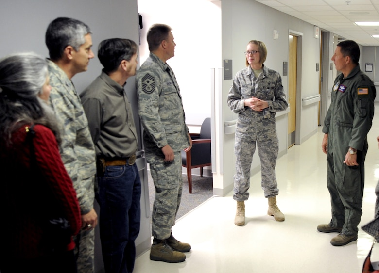 Airman 1st Class Brooke Moore, center, briefs Lt. Gen. Mike Gould, Chief Master Sgt. Todd Salzman and others during a tour of the renovated Air Force Academy Clinic Jan. 22, 2010. The renovations consolidated medical services previously located at the Academy's Milazzo Community Center into the existing facility. Airman Moore is assigned to the 10th Medical Operations Squadron. General Gould is the Academy superintendent, and Chief Salzman is the Academy's command chief master sergeant. (U.S. Air Force photo/Johnny Wilson)