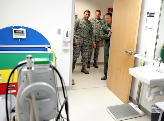 Lt. Gen. Mike Gould (right), Col. Rick LoCastro (left) and Chief Master Sgt. Todd Salzman (center) peek into a newly renovated room in the Academy Clinic Jan. 22. The renovations to 61,000 square feet at the clinic allows the 10th Medical Group to centralize its services and provide better medical care for patients. General Gould is the Academy superintendent; Colonel LoCastro is the 10th Air Base Wing commander, and Chief Salzman is the Academy command chief master sergeant. (U.S. Air Force photo/Johnny Wilson)