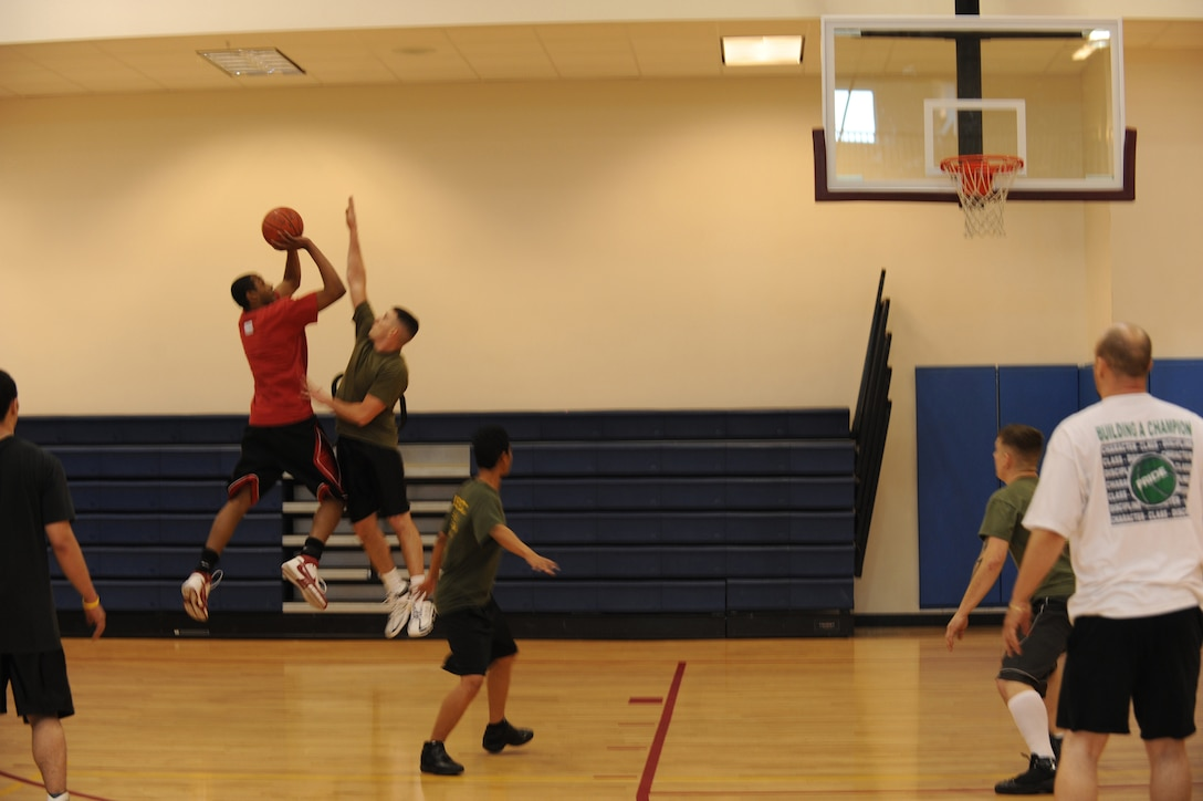 BUCKLEY AIR FORCE BASE, Colo.--Staff Sgt. Alfred Davis, 4th Manpower Requirements Squadron, takes a shot during the 3 on 3 Hoops Classic at the Buckley Fitness Center Jan. 27. (U.S. Air Force by Airman 1st Class Marcy Glass)