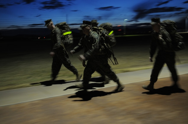 Marines from the station's Installation Personnel Administration Center complete a 5-mile course at the Marine Corps Air Station in Yuma, Ariz., Jan. 28, 2010, in order to prepare for the Bataan Memorial Death March in New Mexico on March 21, 2010. The event celebrates the adversity and hardships faced by the nearly 75,000 Americans and Filipinos forced across the Bataan Peninsula to internment camps by the Japanese during World War II.