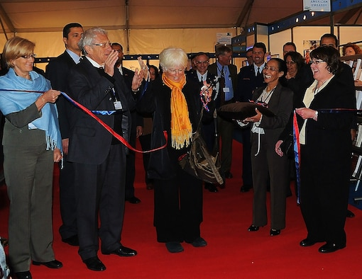 MARRAKECH, Morocco -- Mrs. Silvia Kaplain, wife of the U.S. Ambassador to Morocco, Mr. Sam. Kaplan, cuts the ribbon to the opening of the U.S. Embassy pavilion Jan. 27 at the Marrakech Aeroexpo 2010. The pavilion holds all of the U.S. industry displays including a U.S. Embassy section. The purpose of the Aeroexpo is to build on relationships and to bring major players in the aeronautics industry to showcase their aviation technology. (U.S. Air Force photo by Staff Sgt. Stefanie Torres)