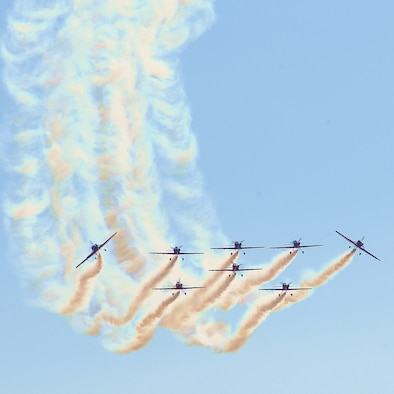 MARRAKECH, Morocco -- The Royal Moroccan Air Force aerobatic display team, the Green March, flies during the Marakech Aeroexpo 2010 Jan. 27. The CAP 232 aircraft are flown in close formation while tied together with ropes. Approximately 50 Airmen and four aircraft from bases in the U.S. and Europe are participating in the Aeroexpo Marrakech 2010 international air show in Morocco which began Wednesday and runs through Saturday. (U.S. Air Force photo by Staff Sgt. Stefanie Torres)