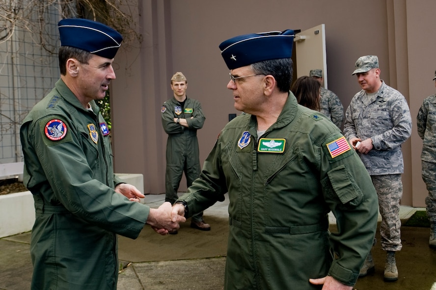 Gen. Raymond E. Johns, Jr., Air Mobility Command commander, shakes hands with Brig. Gen. Gary Magonigle, Assistant Adjudant General and Washington Air National Guard commander, after a brief tour of the Western Air Defense Sector Saturday. (U.S. Air Force Photo/Abner Guzman)