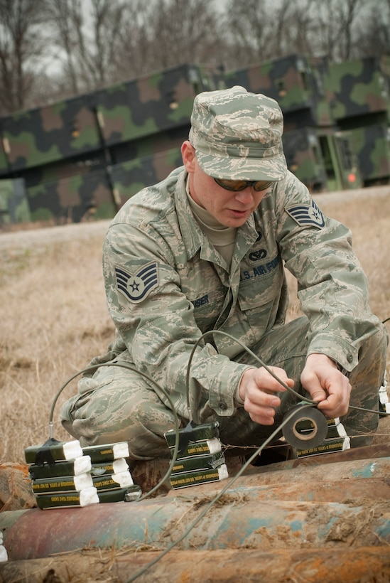 Staff Sgt. Matthew ?Mouse? Meuser of the Kentucky Air National Guard secures detonation cord that has been inserted into C-4 plastic explosives at Camp Atterbury, Ind. Cutting open the ordnance verifies that it does not contain high explosives and that the items are safe to be removed from the range. (U.S. Air Force photo/Tech. Sgt. D. Clare)