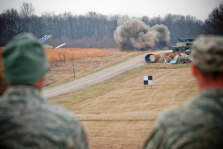 Explosive ordnance disposal technicians from the Kentucky Air National Guard watch a controlled detonation of ordnance at the Camp Atterbury Air-to-Ground Gunnery Range, Camp Atterbury, Ind. While the excitement of a detonation is rewarding for the Airmen, safety is their primary goal in combat, stateside missions and training evolutions.