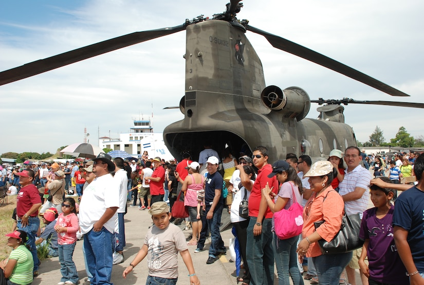 A crowd of spectators stand near a U.S. Army CH-47 Chinook to watch the 2010 Ilopango Air Show in Ilopango El Salvador, Jan. 30. The U.S. military participated in the air show with an HH-60 Black Hawk and a CH-47 Chinook from Joint Task Force-Bravo, Soto Cano Air Base, Honduras, along with two U.S. Air Force B-1B Lancers from the 7th Bomb Wing, Dyess Air Force Base, Texas, drawings crowds of approximately 18,000 people to the air show Jan. 30-31. (U.S. Air Force photo by 1st Lt. Jen Richard)