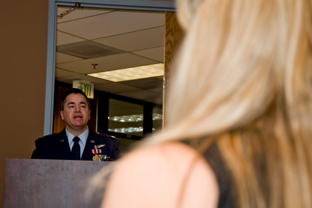 U.S Air Force Lt. Col. Paul E. Shingledecker, 140th Wing Medical Group Commander speaks to the 140th Medical Group as his wife Jodi Shingledecker watches on, Buckley Air Force Base January 30,2010.  Shingledecker has officially assumed command of the 140th Medical Group after serving as the interim commander for 4 months.  (U.S. Air Force photo/Tech. Sgt. Wolfram M. Stumpf)(RELEASED)