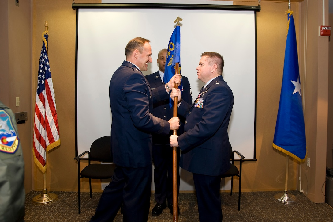 U.S. Air Force Lt. Col. Paul E. Shingledecker, 140th Wing Medical Group Commander (right) assumes  command of the 140th Medical Group as he takes the group's Command Flag from U.S. Air Force Brig. Gen. Trulan Eyre, 140th Wing Commander (left), Buckley Air Force Base January 30, 2010.  Shingledecker is officially assuming command of the 140th Medical Group after serving as the interim commander for 4 months.  (U.S. Air Force photo/Tech. Sgt. Wolfram M. Stumpf)(RELEASED)