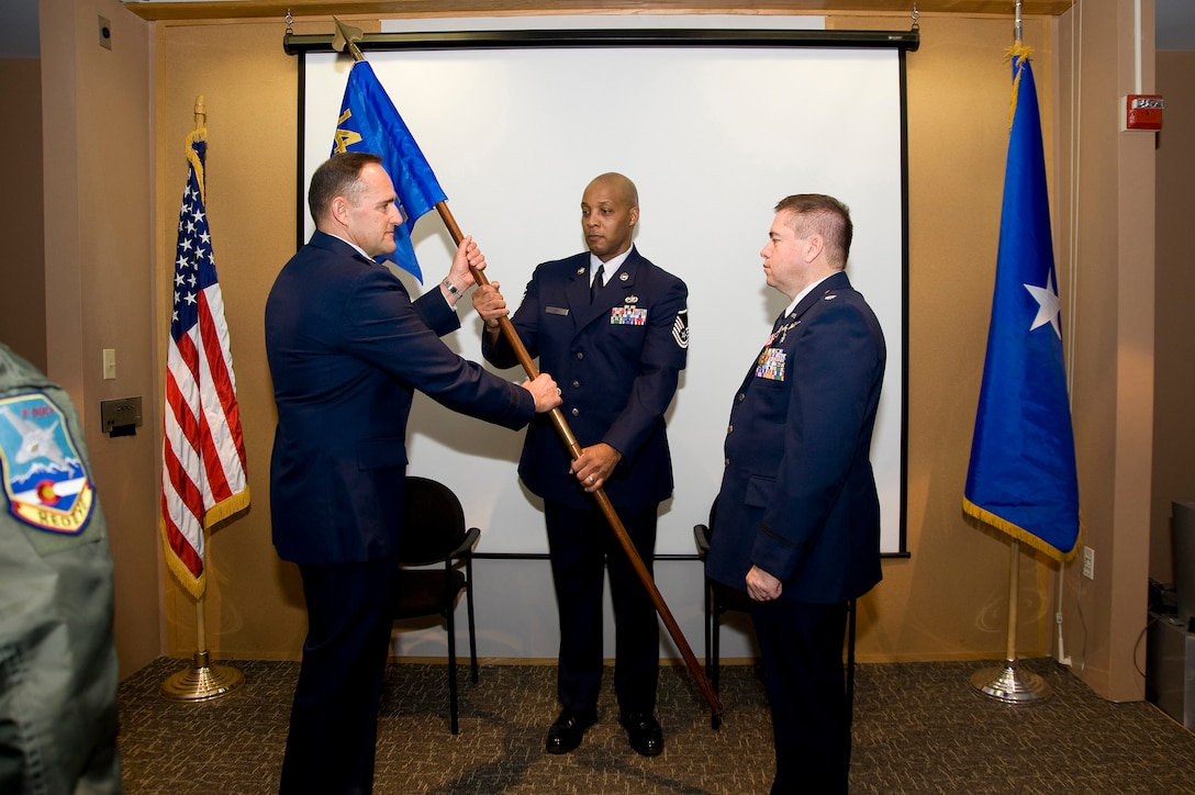 U.S. Air Force Brig. Gen. Trulan Eyre, 140th Wing Commander takes the 140th Medical Group Command Flag as he is about to present it to U.S. Air Force Lt. Col. Paul E. Shingledecker, 140th Interim Medical Group Commander, Buckley Air Force Base January 30, 2010.  Shingledecker is officially assuming  command of the 140th Medical Group after serving as the interim commander for 4 months.  (U.S. Air Force photo/Tech. Sgt. Wolfram M. Stumpf)(RELEASED)