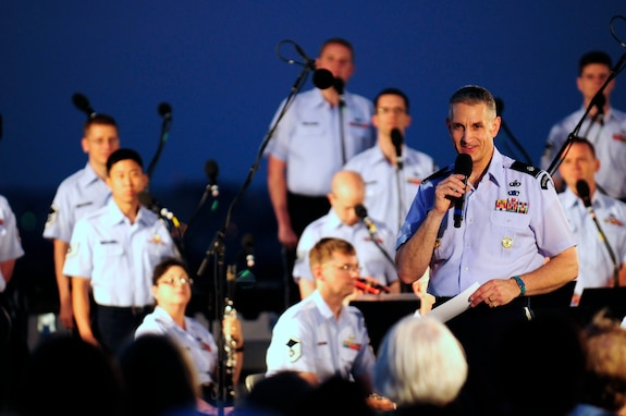 Lt. Col. A. Phillip Waite, United States Air Force Band commander, speaks to the audience during his first public concert June 18. The Band's six performing ensembles take turns performing throughout the summer at the Air Force Memorial each Wednesday and Friday with no fee for attendance. Lt. Col. A. Phillip Waite assumed command of the Air Force Band in a change-of-command ceremony June 1. (U.S. Air Force photo by Staff Sgt. Raymond Mills)