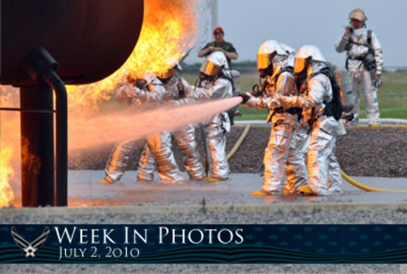 Air Force Week in Photos for July 2, 2010, highlights photos from around the Air Force. In this photo by Master Sgt. Bob Barko Jr., 910th Civil Engineer Squadron firefighters conduct a demonstration at the Youngstown Air Reserve Station, Ohio, fire pit as German reserve officer Lt. Col. Patrick Hofmann looks on. (U.S. Air Force photo illustration/Corey Parrish)