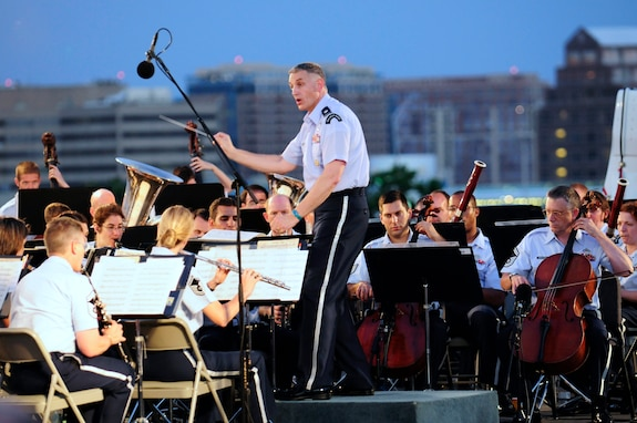 Lt. Col. A. Phillip Waite, United States Air Force Band commander, conducts the Air Force Band's Concert Band during his first public concert June 18. The Band's six performing ensembles take turns performing throughout the summer at the Air Force Memorial each Wednesday and Friday with no fee for attendance. Lt. Col. A. Phillip Waite assumed command of the Air Force Band in a change-of-command ceremony June 1. (U.S. Air Force photo by Staff Sgt. Raymond Mills)