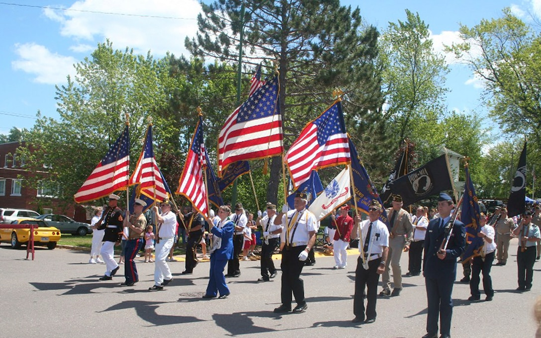 A color guard leads a parade for Independence Day festivities in Wakefield, Mich., on July 4, 2009. (U.S. Air Force photo/Tech. Sgt. Scott T. Sturkol)