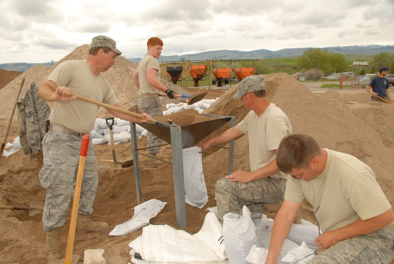 LANDER, Wyo. -- Wyoming National Guard Airmen work together to fill sand bags in an effort to assist Fremont County residents with protecting their homes and properties June 11. The state of Wyoming activated more than 200 National Guardsmen to assist with various emergency activities for the Fremont County Flood 2010 operation.