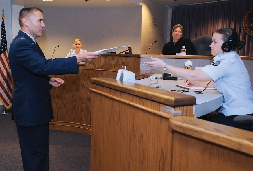 Captain Miguel Acosta, 316th Wing Judge Advocate chief of adverse actions, and Staff Sgt. April Bosquez, 316th Wing JA paralegal, practice trial procedures in the court room June 28. The JA office provides legal services that support the operation, people, infrastructure, and security of the installation. (U.S. Air Force photo/ Senior Airman Melissa Brownstein)