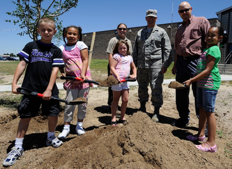 BUCKLEY AIR FORCE BASE, Colo. -- Collin Hagans, Sasha Laity, Quinn Duncan and Jasmin Cole, base dependents, pose with Krystal Phillips, 460th Civil Engineer Squadron fish and wildlife biologist, Lt. Col. William Morrison, 460th Mission Support Group deputy commander and Keith Wood, a Colorado State Forester, after planting a tree at the Arbor Day celebration June 30. (U.S. Air Force photo by Staff Sgt. Dallas Edwards)
