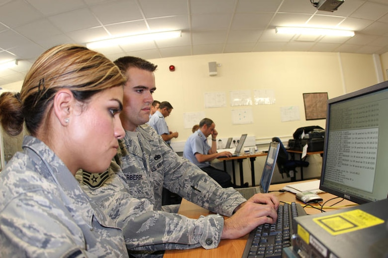Staff Sgt. Gabriel Scarberry 373rd Training Squadron, provides Voice over Internet Protocol (VoIP) equipment training to Senior Airman Denise Gonzalez, 52nd Combat Communications Squadron during United Architecture 2010.  UA2010 is a US-UK interoperability communications exercise held at RAF Lemming, United Kingdom June 21 to July 2. (US Air Force photo by Master Sgt. Robert Talenti)