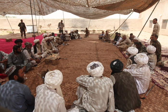 Northern Marjah elders meet during a shura held at Combat Outpost Coutu, Helmand province, Afghanistan, July 5, 2010. Elders met with Marines and Afghan police to discuss recent security issues of concern. The Marines and Afghan National Police pushed forward with the shura, despite a less than expected turnout, to discuss security concerns throughout northern Marjah.