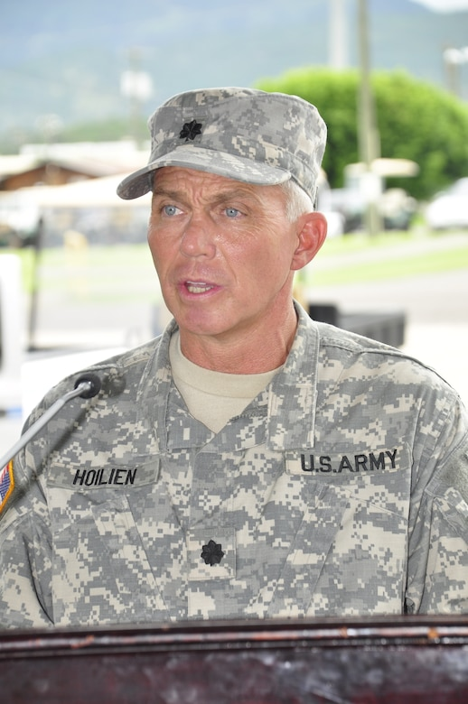 SOTO CANO AIR BASE, Honduras --  Lt. Col. Michael Hoilien, the new Medical Element commander here, speaks at the MEDEL change of command ceremony here June 17. Colonel Hoilien took command from Col. Marie Dominguez. (U.S. Air Force photo/Martin Chahin)