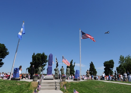 A C-130 from the Niagara Falls Air Reserve Station executes a flyover during the Dedication of the City of Tonawanda All Heroes' Memorial July 3, 2010, Tonawanda NY. This new memorial was dedicated to all natives of the City of Tonawanda who had given their lives in service to their country. (U.S. Air Force photo by Staff Sgt. Joseph McKee)