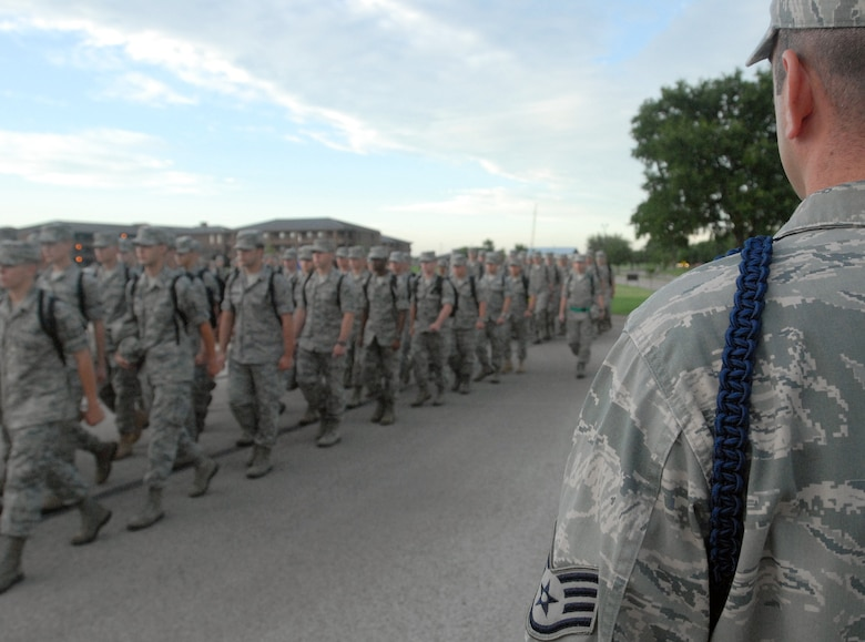 A Military Training Leader, from the 316th Training Squadron Goodfellow AFB, TX, keeps an eye on a formation of Airman as they march to class June 6. MTL's ensure that the lessons learned in Basic Military Training are reinforce as each new Airman progresses through their technical training and leave for their first assignment. (U.S. Air Force photo/Master Sgt. Randy Mallard)