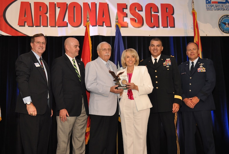 Pictured from left to right, Arizona ESGR Field Chairman Scott Essex, NCESGR Deputy Executive Director Phil Pope, Arizona Chair Emeritus Bill Valenzuela,  Arizona Governor Jan Brewer, Arizona Adjutant General Maj. Gen. Hugo Salazar, and Commander, 162nd Fighter Wing, Arizona Air National Guard, Brig. Gen. Gregory Stroud present Bill Valenzuela his ESGR Lifetime Achievement Award for more than 30 years of dedicated service with the Arizona ESGR Field Office. Mr. Valenzuela continues to be a staunch supporter of ESGR and the service members they serve.  (Army photo by Sgt. Ed Balaban)