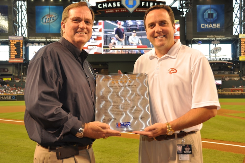 Arizona ESGR Field Chairman Scott Essex presents the Arizona Diamondbacks Team President Derrick Hall with an ESGR Statement of Support plaque during the Military Appreciation day pre-game show at home plate.  Mr. Hall earlier in the day signed an ESGR Statement Support demonstrating the Arizona Diamondbacks' support of the men and women who serve in the Guard and Reserves.  Mr. Hall also was presented an ESGR coin by Mr. Essex for the Diamondbacks continued support of the military men and women and their families. (Army photo by Sgt. Ed Balaban)