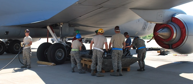 Joint Air Force Reserve and Air National Guard maintenance teams practice CDDAR (Crashed, Damaged, Disabled and Recovery) skills during a recent exercise at Tinker Air Force Base.  Shown here maintenance crews from the 507th Maintenance Group and 137th Maintenance Group set up a platform and lifting bag to simulate the process that would be used to lift a damaged aircraft for repairs.