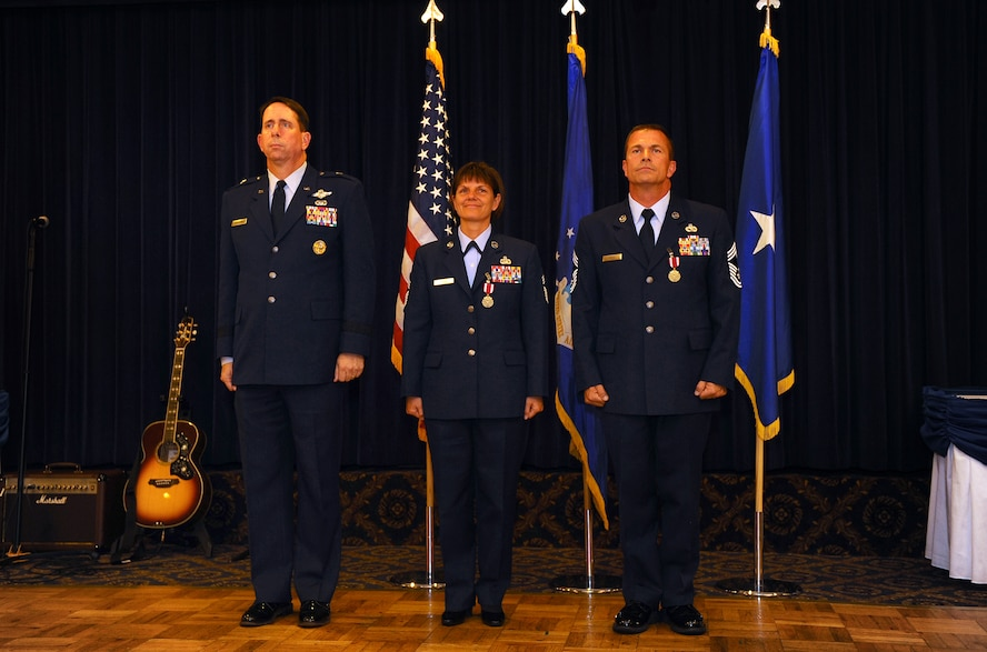 OFFUTT AIR FORCE BASE, Neb. - Brig. Gen. John N.T. Shanahan, commander, 55th Wing, acts as the presiding officer for the dual retirement ceremony honoring Chief Master Sgts. Lisa and Roger Sirois at the Patriot Club, July 6.  With over 60 years of combined service, Chiefs Lisa and Roger Sirois' retirement ceremony symbolized both a commitment to the service of this country as well as one another.U.S. Air Force Photo by Josh Plueger