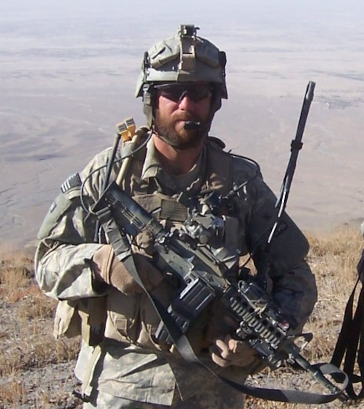 TACP with Gear: A bearded TACP member with a few indispensables.  TACPs imbedded with Special Forces units are sometimes allowed to grow beards and
