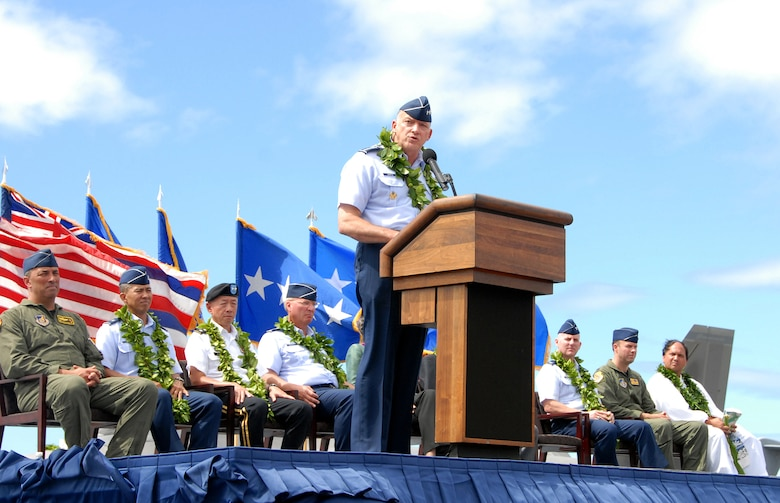 """The F-22 Arrival Ceremony official party looks on as Gen. Gary L. North, commander, Pacific Forces, delivers a speech during ceremony July 9, on Joint Base Pearl Harbor-Hickam, Hawaii. """"The arrival of the third squadron of F-22s to be based in the Pacific region is a tangible reminder of our U.S. commitment to peace and stability in the region. America, its alllies, partners and friends, have enjoyed the freedom of action provided by air dominance for over 50 years. Our 5th Generation USAF F-22 Raptor will ensure that edge continues for the next 50 years and beyond,"""" said Gen. North. (U.S.Air Force photo/Tech. Sgt. Betty J. Squatrito-Martin)"""