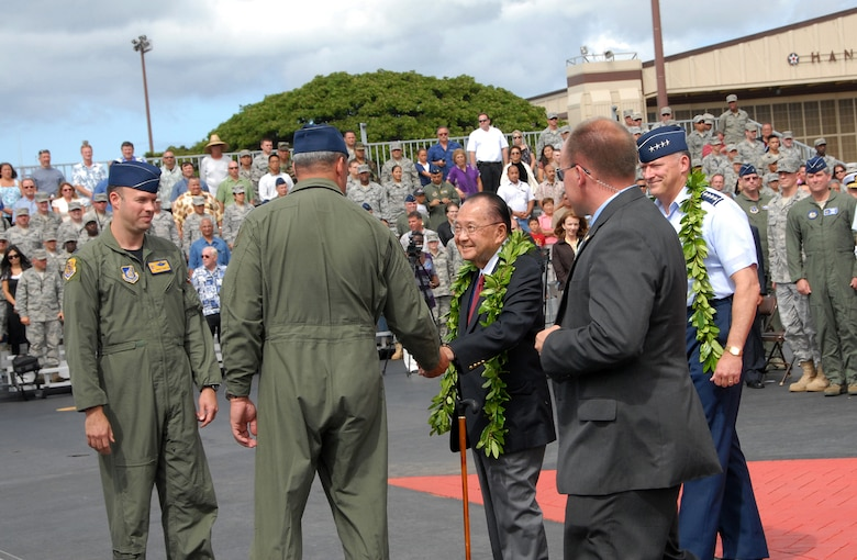 """During F-22 Arrival Ceremony July 9, on Joint Base Pearl Harbor-Hickam, F-22 pilots, Lt. Col. Harvey """"Banger"""" Newton, 19th Fighter Squadron and Lt. Col. Christopher """"Frenchy"""" Faurot, 154th Wing, Hawaii National Guard, greet Senator Daniel K. Inouye as he arrives for the ceremony. Senator Inouye is followed by Gen. Gary L. North, commander, Pacific Air Forces. (U.S. Air Force photo/Tech. Sgt. Betty J. Squatrito-Martin)"""