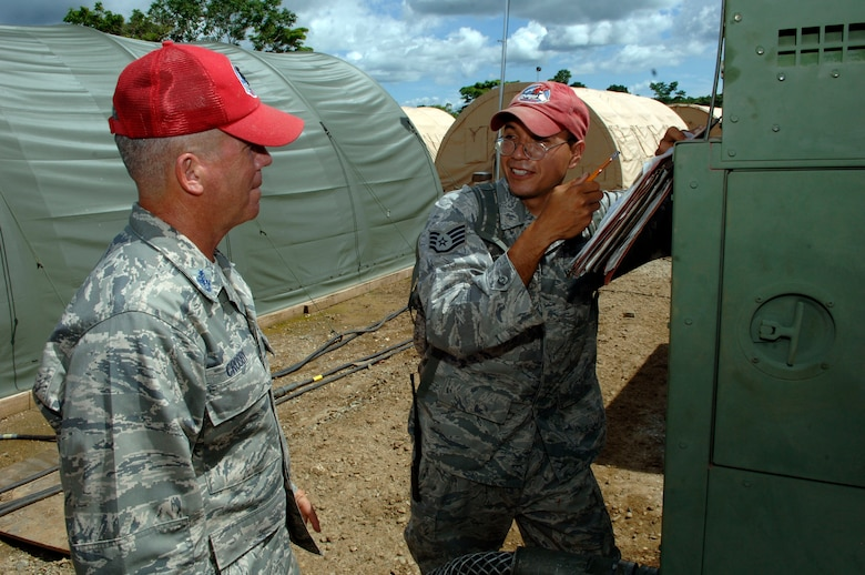 "METETI, Panama -- Senior Chief Petty Officer Shawn Crosby (left) and Staff Sgt. Oscar Perez, 820th Expeditionary RED HORSE Squadron, discuss the power production plan for the base camp housing more 250 Airmen, Soldiers, Sailors and Marines taking part in New Horizons Panama 2010, a U.S. Southern Command sponsored humanitarian assistance mission. Crosby is the ""Mayor"" of tent city, responsible for for the day-to-day functioning of the camp, including the facilities, utilities, roads and people. (U.S. Air Force photo/Tech. Sgt. Eric Petosky)"