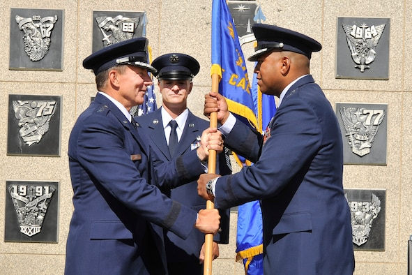 Brig. Gen. Richard Clark accepts the commandant of cadets guidon from Air Force Academy Superintendent Lt. Gen. Mike Gould during a change-of-command ceremony at the Academy in Colorado Springs, Colo., July 9, 2010. Prior to this assignment, General Clark was the vice commander of 8th Air Force (Air Forces Strategic) at Barksdale Air Force Base, La. He is a 1986 graduate of the Academy. (U.S. Air Force photo/Bill Evans)