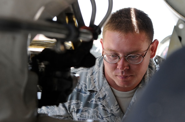 BARKSDALE AIR FORCE BASE, La. -- Tech. Sgt. Jeffery Durham, 96th Bomb Squadron, inspects the brakes and landing gear on a B-52H Stratofortress. Sergeant Durham is a dedicated crew chief and his job is to help ensure combat capability for Barksdale's fleet of B-52's. (U.S. Air Force photo by Senior Airman Megan M. Kittler) (RELEASED)