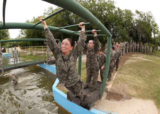 Air Force Basic Military Training trainees begin the monkey bars obstacle June 30. In BMT, trainees learn the critical importance of discipline, teamwork and foundational knowledge needed to succeed as an Airman. (U.S. Air Force photo/Robbin Cresswell)
