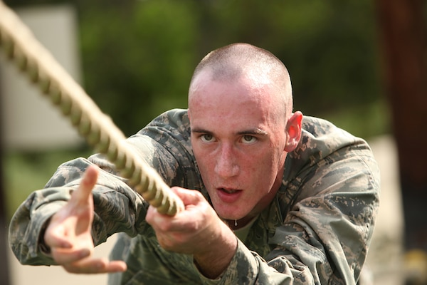An Air Force Basic Military Training trainee completes an obstacle June 30. The BMT obstacle course tests a trainee's strength, endurance, and will power. (U.S. Air Force photo/Robbin Cresswell)