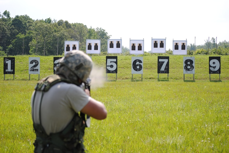 A competitor in the 2010 Tennessee National Guard shooting competition takes a standing firing position and fires on his target.