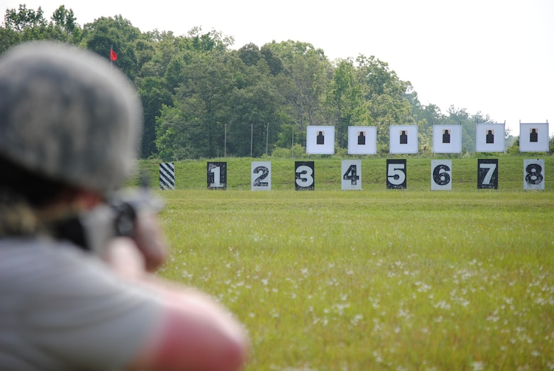 A competitor in the 2010 Tennessee National Guard shooting competition takes a kneeling firing position before aquiring his target.