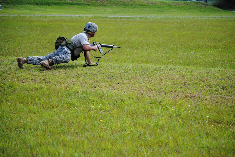 A competitor in the 2010 Tennessee National Guard shooting competition takes a prone firing position before aquiring his target.