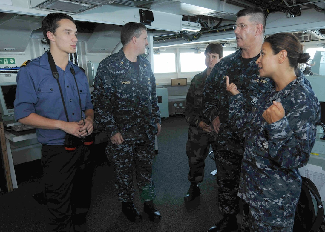 USS Kearsarge's Meteorological Officer, Lt. Cristal Armijo, explains the differences in size of the spaces between amphibious landing platform dock  HMS Albion and Kearsarge. Albion is participating in Composite Training Unit Exercise along with six other Royal Navy Ships, the Kearsarge Amphibious Readiness Group and 26th MEU.