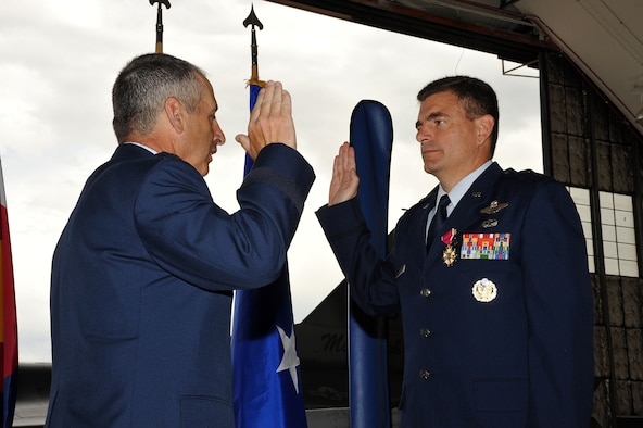 The Adjutant General of Colorado Maj. Gen. H. Michael Edwards administers the Oath of Office to Brig. Gen. Michael Loh July 10.  Loh will be relocating to Washington D.C. to serve as the Air National Guard advisor to the Air Force Chief of Staff.  He is  the former 140th Operation Group Commander, 140th Wing, Colorado Air National Guard, Buckley Air Force Base, Colo.  Loh has been a pilot for the 120th Fighter Squadron at Buckley AFB since 1991.  U.S. Air Force Photo By: Tech. Sgt. Wolfram M. Stumpf (Released)
