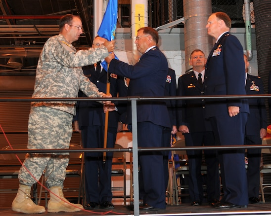 Major General Brian Tarbet, Adjutant General for the Utah National Guard, passes the flag to Colonel Wayne Lee, who assumed command as the Assistant Adjutant General of the Utah Air National Guard in a ceremony on July 10, 2010, at the 151st Air Refueling Wing, Salt Lake City. (U.S. Air Force photo by MSgt Gary J. Rihn)