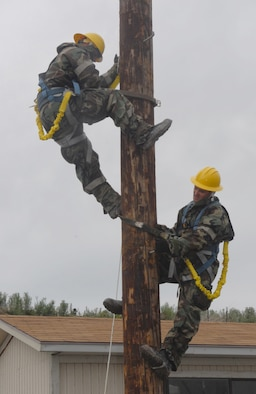 Members of the 130th EIS climb a telephone pole to set up an antenna during the unit's ORE in preparation for their upcoming UCI in May.  (U.S. Air Force photo by Airman 1st Class Emily Hoferitza)