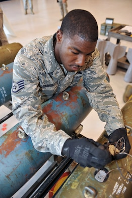 WHITEMAN AFB, Mo. - Staff Sgt. Tyler Campbell, 509th Munitions Squadron, installs an arming device into a 500-pound MK-82 bomb during a practice session for the Air Force Global Strike Command Challenge, Jul. 12. Sergeant Campbell was assigned to install the arming devices on each of the 12 bombs during the practice session.