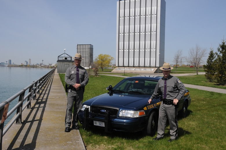 (On left) New York State Troopers Edward Stefik, current 107th AW, New York Air National Guardsman and William Persinger, former 1st Battalion 108th Infantry, New York Army National Guardsman earn the 2009 Lawman of the Year award for their lifesaving actions. The Troopers are standing adjacent to the Power Authority water control gates where the rescue occured. (U.S. Air Force photo/ Staff sgt. Peter Dean)